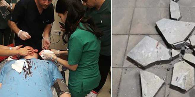 Çocuğun ateşi düşmeyince doktorun başında parke taşı parçaladı