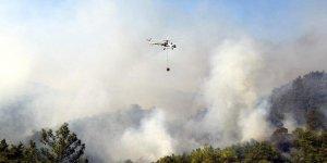 Muğla'daki yangına 10 helikopterle müdahale sürüyor