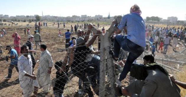 Sınırda telleri yıkıp Suriye`ye geçtiler