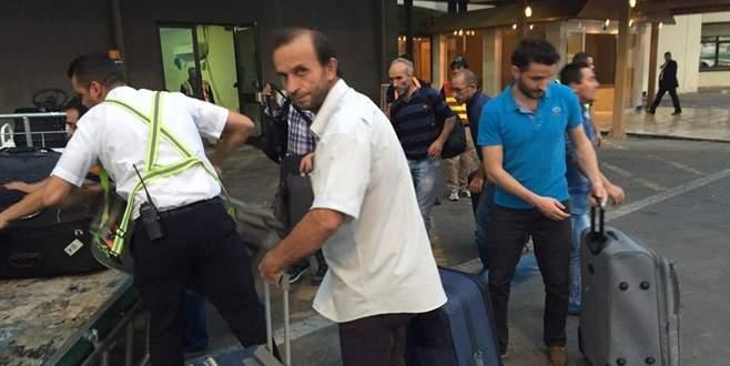 Serbest bırakılan Türk işçiler Ankara'da