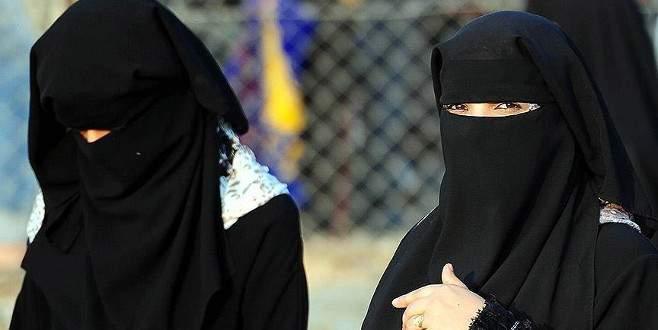 Peçesini çıkarmamak için direnen kadına ceza