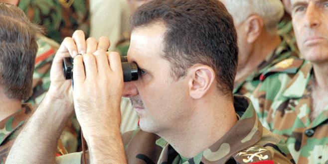 Esad Kürtleri vuruyor