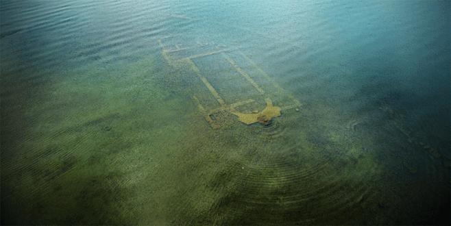 Göl dibindeki bazilikadan sikkeler ve altın küpe çıktı