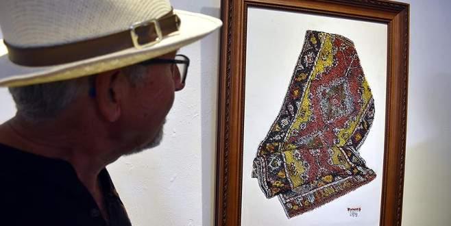 200 yıllık halıyı 60 bin iğneyle tablo haline getirdi