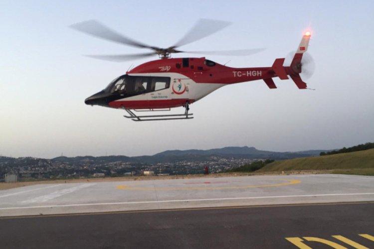 Bursa'da ambulans helikopter traktör kazasında yaralanan genç için havalandı