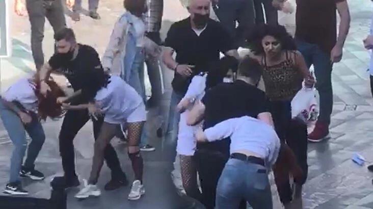 Kızlar cadde ortasında saç saça baş başa kavga etti
