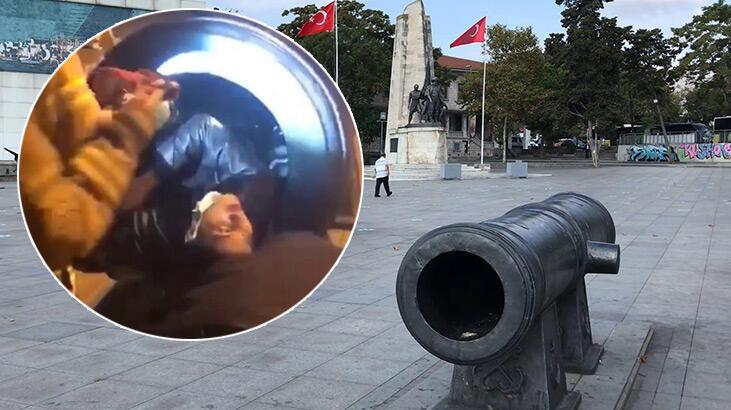 Fotoğraf çektirmek için girdi, tarihi topun içinde mahsur kaldı
