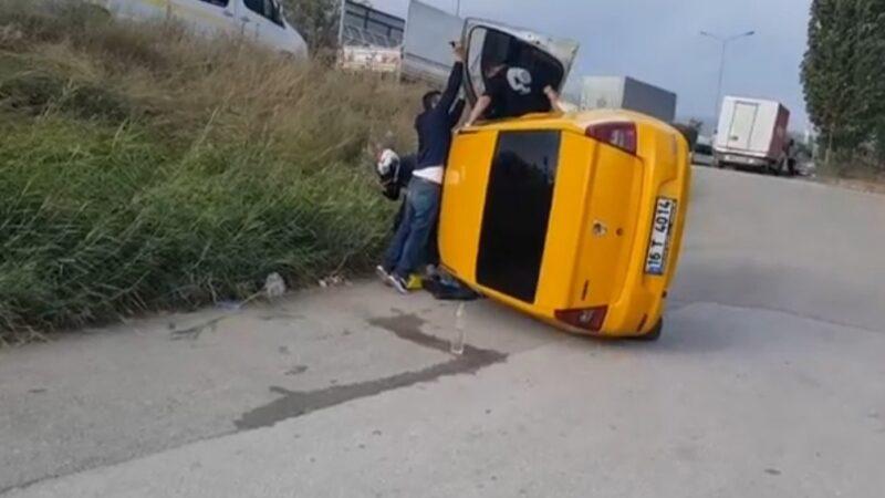 Bursa'da feci kaza! Kamyonun sıkıştırdığı taksi takla attı